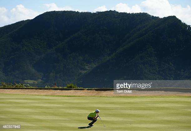 Elias Bertheussen of Norway lines up a putt on the 4th green during day one of the Madeira Islands Open Portugal BPI at Club de Golf do Santo da...