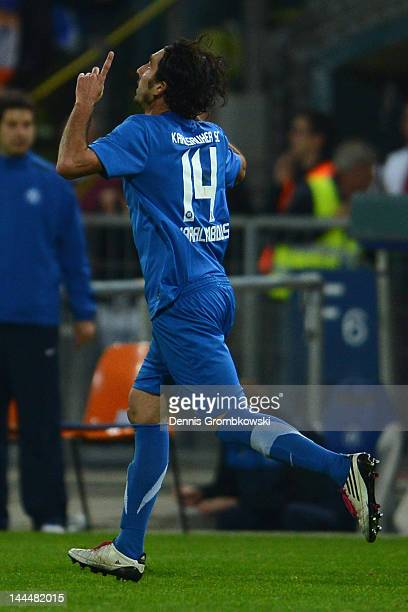 Elias Charalambous of Karlsruhe celebrates after scoring his team's second goal during the Second Bundesliga relegation match between Karlsruher SC...