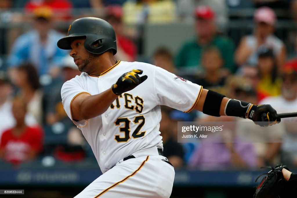 Elias Diaz #32 of the Pittsburgh Pirates hits into a double play scoring a run in the second inning against the St. Louis Cardinals at PNC Park on August 19, 2017 in Pittsburgh, Pennsylvania.