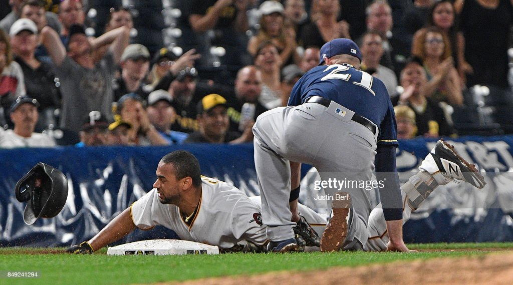 Elias Diaz #32 of the Pittsburgh Pirates is tagged out at third base by Travis Shaw #21 of the Milwaukee Brewers while attempting to stretch a double into a triple in the seventh inning during the game at PNC Park on September 18, 2017 in Pittsburgh, Pennsylvania.
