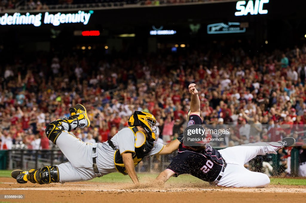 Elias Diaz #32 of the Pittsburgh Pirates tags out Daniel Murphy #20 of the Washington Nationals at home plate in the first inning at Nationals Park on September 29, 2017 in Washington, DC.