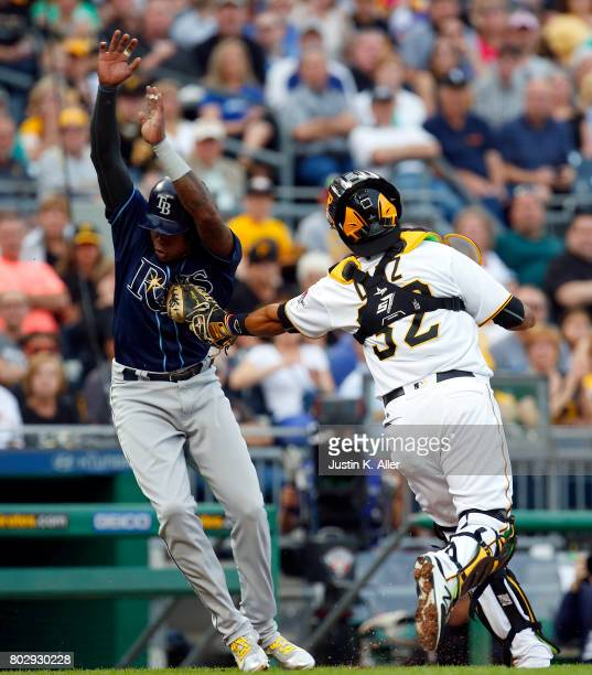 Elias Diaz of the Pittsburgh Pirates tags out Tim Beckham of the Tampa Bay Rays in the second inning during interleague play at PNC Park on June 28...