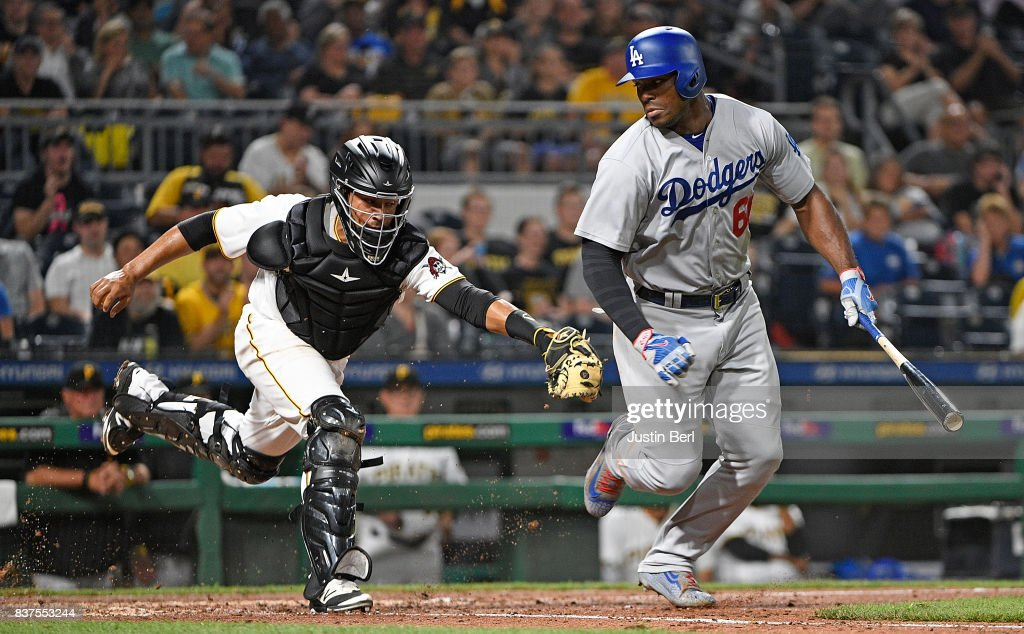 Elias Diaz #32 of the Pittsburgh Pirates tags out Yasiel Puig #66 of the Los Angeles Dodgers after a dropped third strike call in the fifth inning during the game at PNC Park on August 22, 2017 in Pittsburgh, Pennsylvania.