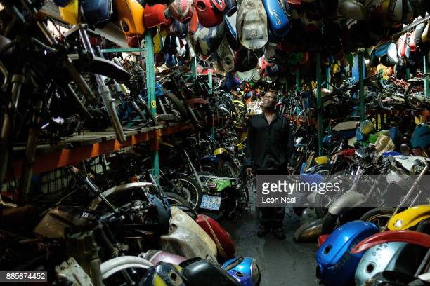 Elias Dube an employee of 34 years poses among a small selection of the motorbike parts at 'The Bike Hospital' on October 18 2017 in Johannesburg...