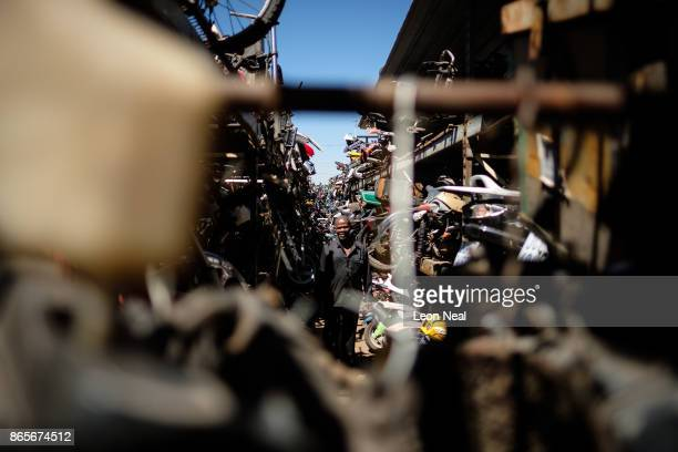 Elias Dube an employee of 34 years walks down one of the tight passageways between shelves of parts at 'The Bike Hospital' on October 18 2017 in...