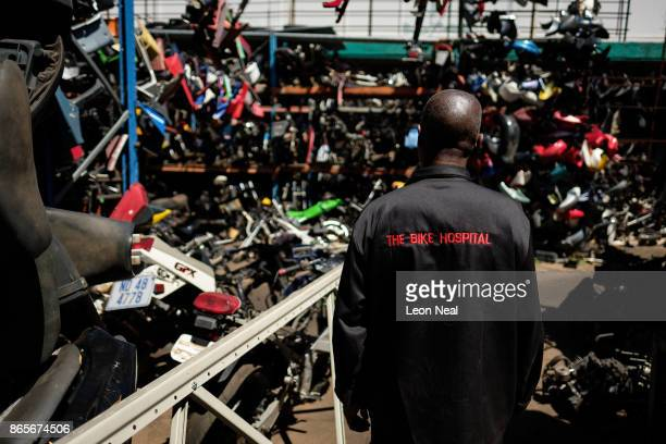 Elias Dube an employee of 34 years walks through the site of 'The Bike Hospital' on October 18 2017 in Johannesburg South Africa The business has...