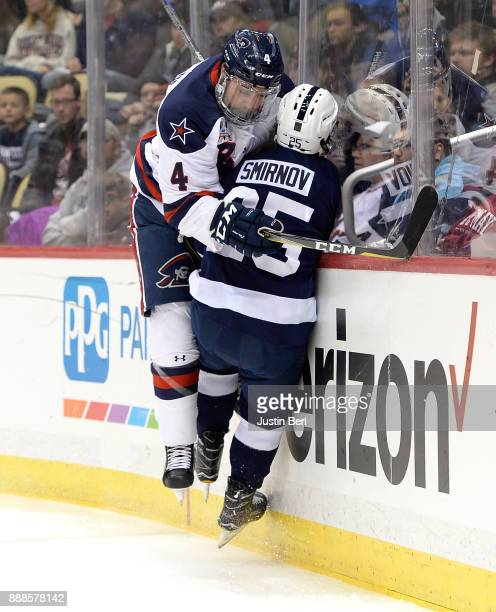 Elias Ghantous of the Robert Morris Colonials throws a hit on Denis Smirnov of the Penn State Nittany Lions in the first period during the game at...