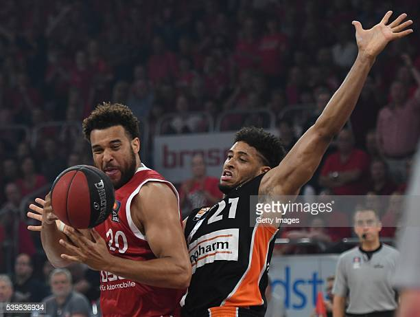 Elias Harris is challenged by Augustine Rubit during game three of the 2016 BBL Finals between Brose Baskets and ratiopharm Ulm at Brose Arena on...