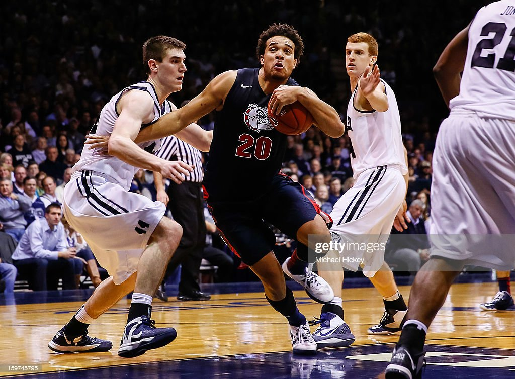 <a gi-track='captionPersonalityLinkClicked' href=/galleries/search?phrase=Elias+Harris&family=editorial&specificpeople=6164446 ng-click='$event.stopPropagation()'>Elias Harris</a> #20 of the Gonzaga Bulldogs makes a move to the basket against <a gi-track='captionPersonalityLinkClicked' href=/galleries/search?phrase=Andrew+Smith+-+Basketballer&family=editorial&specificpeople=7641849 ng-click='$event.stopPropagation()'>Andrew Smith</a> #44 of the Butler Bulldogs at Hinkle Fieldhouse on January 19, 2013 in Indianapolis, Indiana. Butler defeated Gonzaga 64-63.