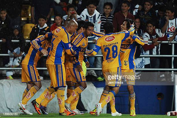 Elias Hernan Hernandez of Tigres celebrates with his teammates a scored goal during a match between Pachuca vs Tigres as part of Clausura 2012...