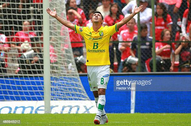 Elias Hernandez of Leon celebrates the third goal of his team scored by Carlos Peña during a 7th round match between Toluca and Leon as part of the...