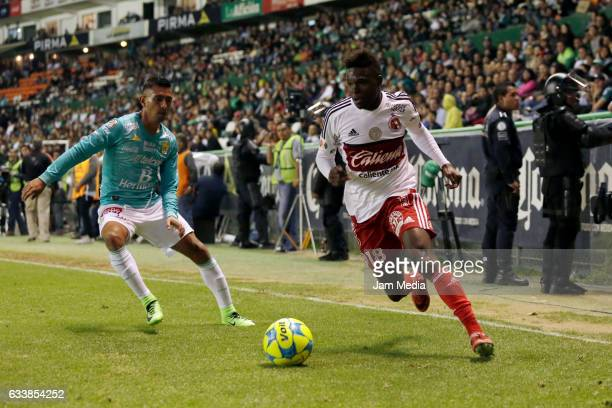 Elias Hernandez of Leon defends against Aviles Hurtado of Tijuana during the 5th round match between Leon and Tijuana as part of the Torneo Clausura...