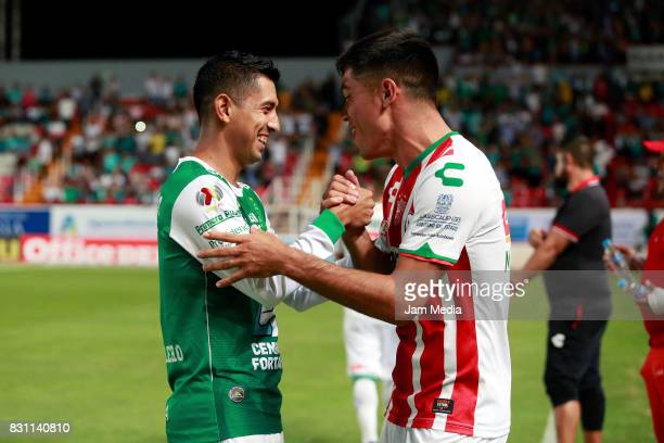 Elias Hernandez of Leon greets Xavier Baez of Necaxa prior to the 4th round match between Necaxa and Leon as part of the Torneo Apertura 2017 Liga MX...