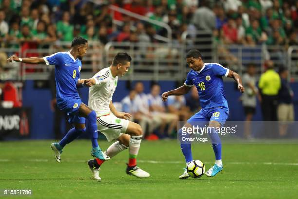 Elias Hernandez of Mexico and Michael Maria of Curacao compete for the ball during a Group C match between Mexico and Curacao as part of CONCACAF...