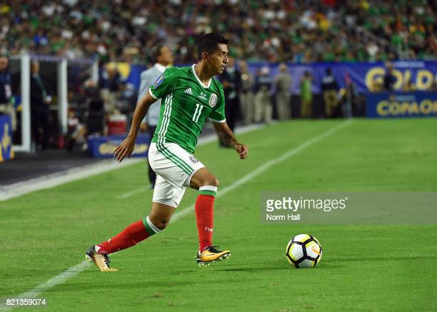 Elias Hernandez of Mexico controls the ball against Honduras in a quarterfinal match during the CONCACAF Gold Cup at University of Phoenix Stadium on...