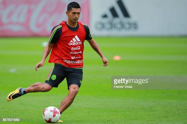 Elias Hernandez of Mexico drives the ball during a Mexico's National Team training session ahead of the Qualifier match against Trinidad Tobago at...