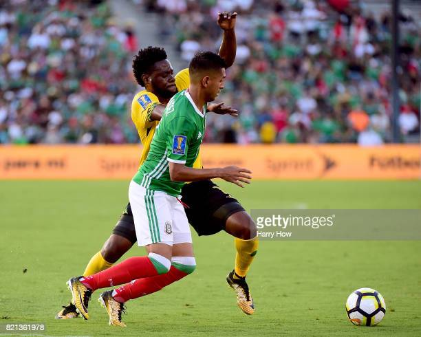Elias Hernandez of Mexico goes after the ball with Ricardo Morris of Jamaica during a 10 Jamaican win in the CONCACAF 2017 semifinal at Rose Bowl on...