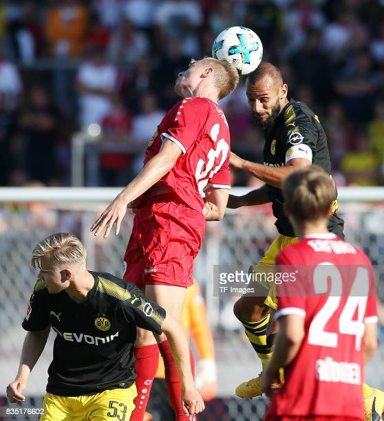 Elias Huth of Erfurt and Oemer Toprak of Dortmund battle for the ball during the preseason friendly match between RotWeiss Erfurt and Borussia...