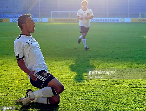Elias Kachunga of Germany celebrates after scoring his team's first goal during the EURO U19 Qualifier match between Germany and Switzerland on...
