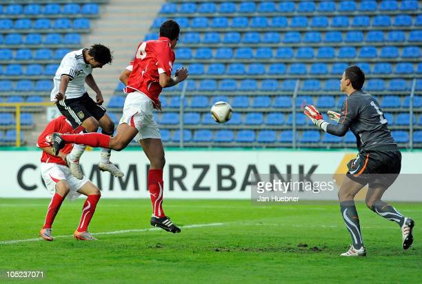 Elias Kachunga of Germany scores against Leo Lacroix and Benjamin Siegrist of Switzerland the 22 goal during the EURO U19 Qualifier match between...