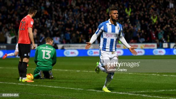 Elias Kachunga of Huddersfield celebrates scoring his team's 3rd goal during the Sky Bet Championship match between Huddersfield Town and Brighton...