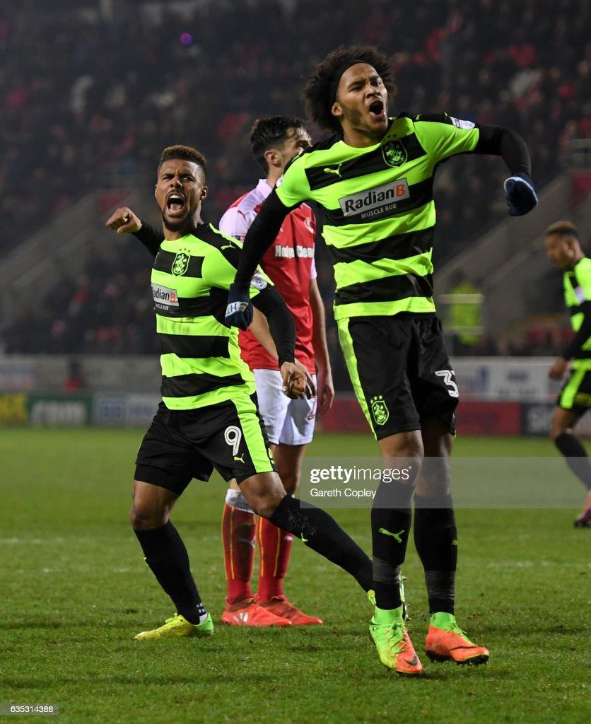 Elias Kachunga of Huddersfield celebrates scoring his team's second goal with Izzy Brown(right) during the Sky Bet Championship match between Rotherham United and Huddersfield Town at The New York Stadium on February 14, 2017 in Rotherham, England.