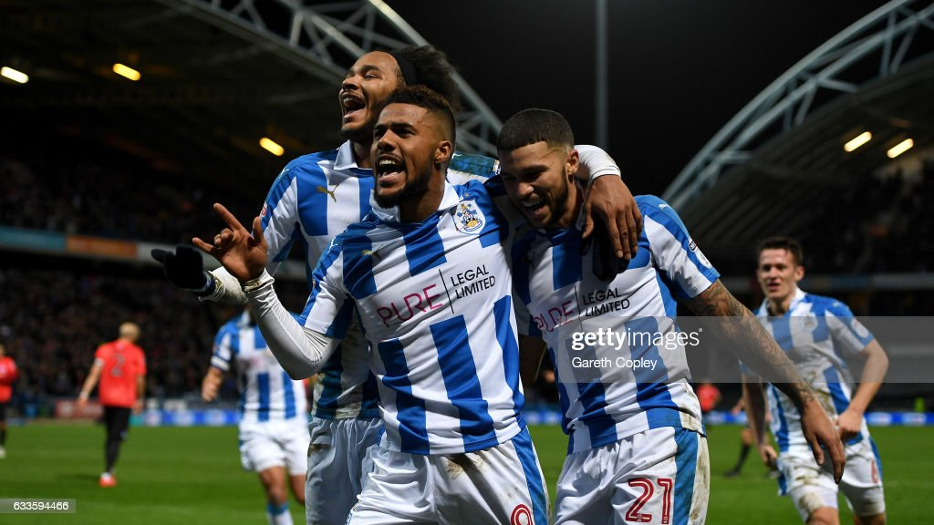 Elias Kachunga of Huddersfield celebrates with Isaiah Brown and Nahki Wells after scoring his team's 3rd goal during the Sky Bet Championship match between Huddersfield Town and Brighton & Hove Albion at Galpharm Stadium on February 2, 2017 in Huddersfield, England.