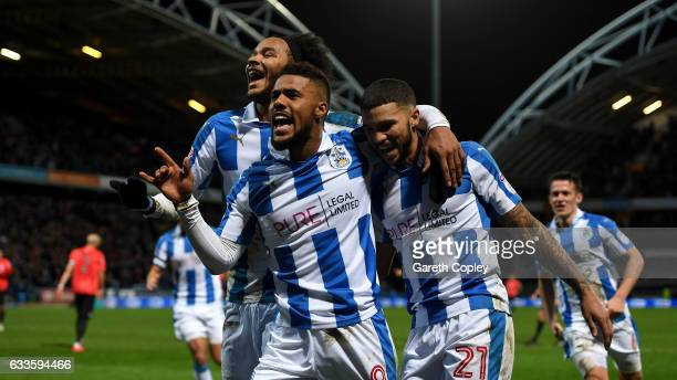 Elias Kachunga of Huddersfield celebrates with Isaiah Brown and Nahki Wells after scoring his team's 3rd goal during the Sky Bet Championship match...