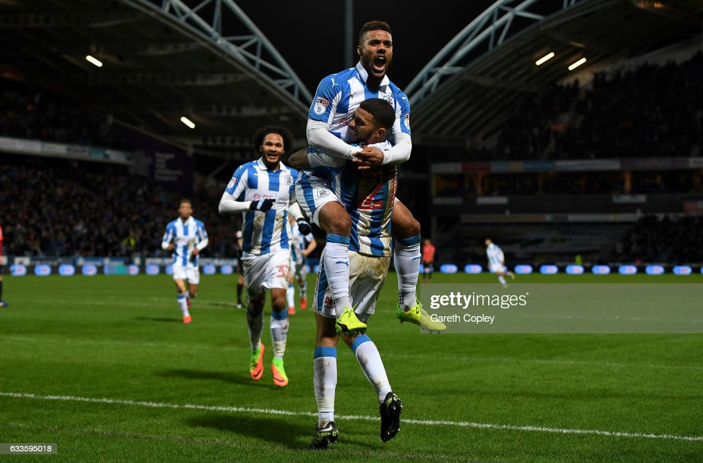 Elias Kachunga of Huddersfield celebrates with Nahki Wells after scoring his team's 3rd goal during the Sky Bet Championship match between Huddersfield Town and Brighton & Hove Albion at Galpharm Stadium on February 2, 2017 in Huddersfield, England.