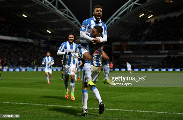 Elias Kachunga of Huddersfield celebrates with Nahki Wells after scoring his team's 3rd goal during the Sky Bet Championship match between...