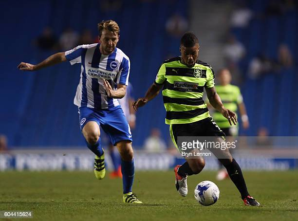 Elias Kachunga of Huddersfield is tackled by Dale Stephens of Brighton during the Sky Bet Championship match between Brighton Hove Albion and...