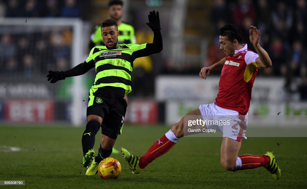 Elias Kachunga of Huddersfield is tackled by Stephen Kelly of Rotherham during the Sky Bet Championship match between Rotherham United and Huddersfield Town at The New York Stadium on February 14, 2017 in Rotherham, England.