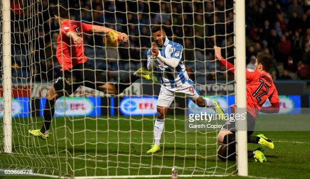 Elias Kachunga of Huddersfield scores his team's 3rd goal during the Sky Bet Championship match between Huddersfield Town and Brighton Hove Albion at...
