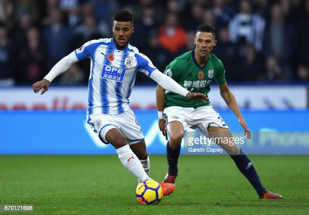 Elias Kachunga of Huddersfield Town and Kieran Gibbs of West Bromwich Albion in action during the Premier League match between Huddersfield Town and...