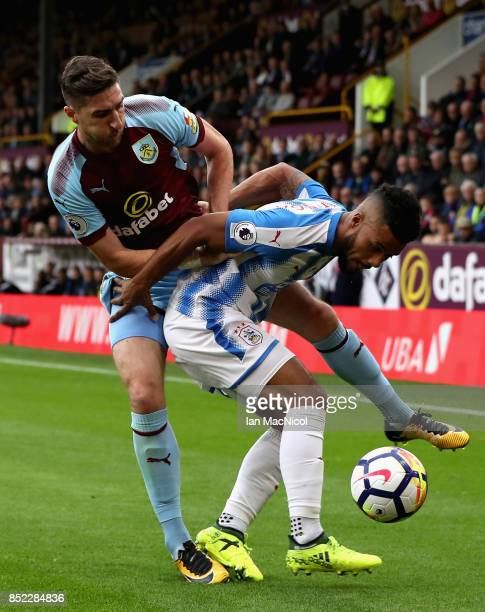 Elias Kachunga of Huddersfield Town controls the ball under pressure of Stephen Ward of Burnley during the Premier League match between Burnley and...