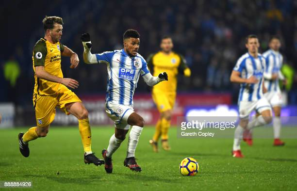 Elias Kachunga of Huddersfield Town is challenged by Dale Stephens of Brighton and Hove Albion during the Premier League match between Huddersfield...