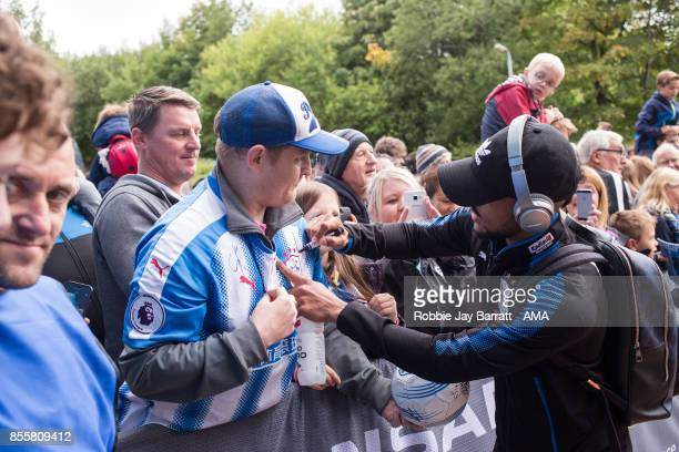 Elias Kachunga of Huddersfield Town signs a fans shirt prior to the Premier League match between Huddersfield Town and Tottenham Hotspur at John...