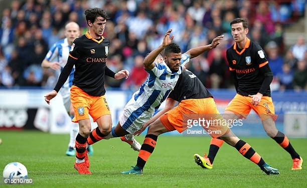 Elias Kachunga of Huddersfield Town trips after a collision with Daniel Pudil of Sheffield Wednesday during the Sky Bet Championship match between...