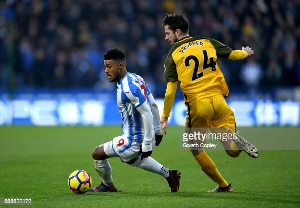 Elias Kachunga of Huddersfield Town turns away from Davy Propper of Brighton and Hove Albion during the Premier League match between Huddersfield...