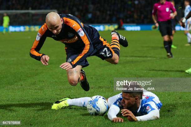 Elias Kachunga of Huddersfield Town wins a penalty under a challenge from Jonjo Shelvey of Newcastle United during the Sky Bet Championship match...
