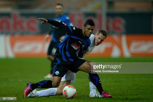 Elias Kachunga of Paderborn and Michael Fink of Aue battle for the ball during the Second Bundesliga match between SC Paderborn and Erzgebirge Aue at...