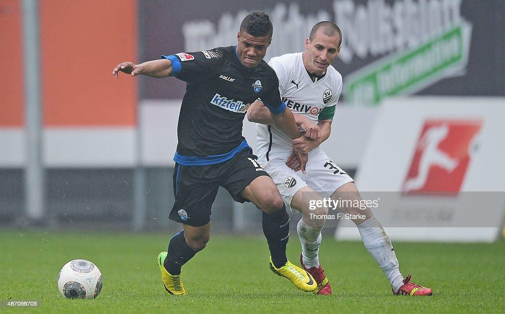 Elias Kachunga (L) of Paderborn and Stefan Kulovits of Sandhausen fight for during the Second Bundesliga match between SC Paderborn and SV Sandhausen at Benteler Arena on April 27, 2014 in Paderborn, Germany.