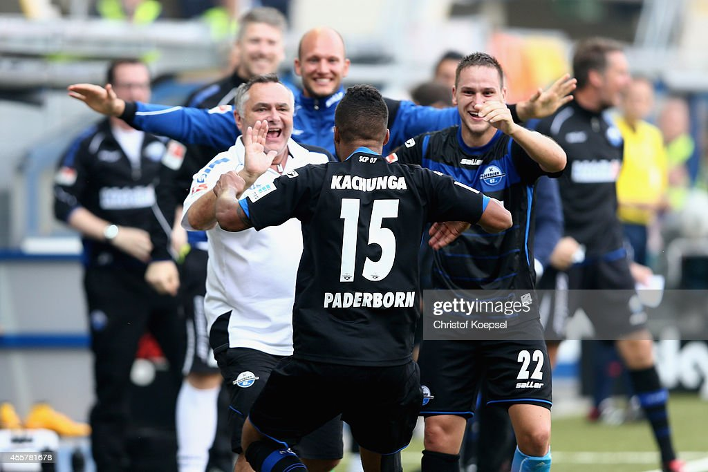 Elias Kachunga of Paderborn celebrates the first goal with kit manager Michael Heppner n and Michael Heinloth of Paderborn during the Bundesliga...