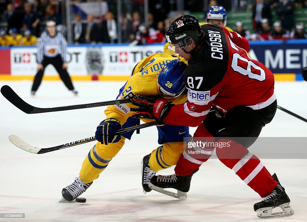 <a gi-track='captionPersonalityLinkClicked' href=/galleries/search?phrase=Elias+Lindholm&family=editorial&specificpeople=8613151 ng-click='$event.stopPropagation()'>Elias Lindholm</a> (L) of Sweden and Sidny Crosby (R) of Canada battle for the puck during the IIHF World Championship group A match between Sweden and Canada at o2 Arena on May 6, 2015 in Prague, Czech Republic.
