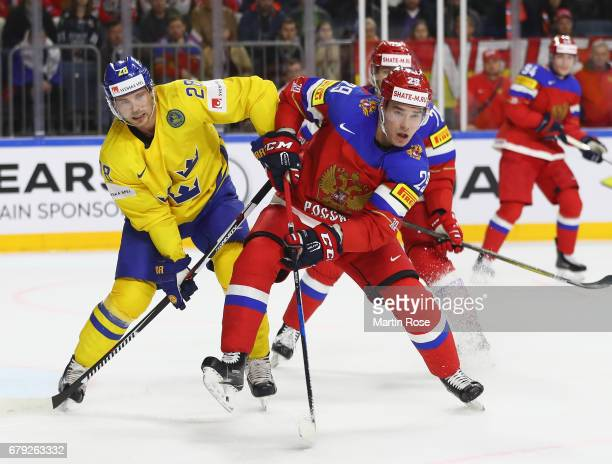 Elias Lindholm of Sweden challenges Ivan Provorov of Russia during the 2017 IIHF Ice Hockey World Championship game between Sweden and Russia at...