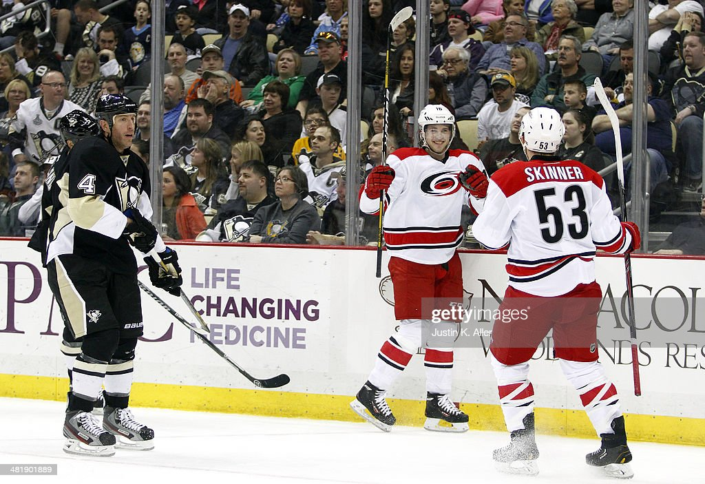 Elias Lindholm #16 of the Carolina Hurricanes celebrates his second goal of the game with Jeff Skinner #53 against the Pittsburgh Penguins during the game at Consol Energy Center on April 1, 2014 in Pittsburgh, Pennsylvania.