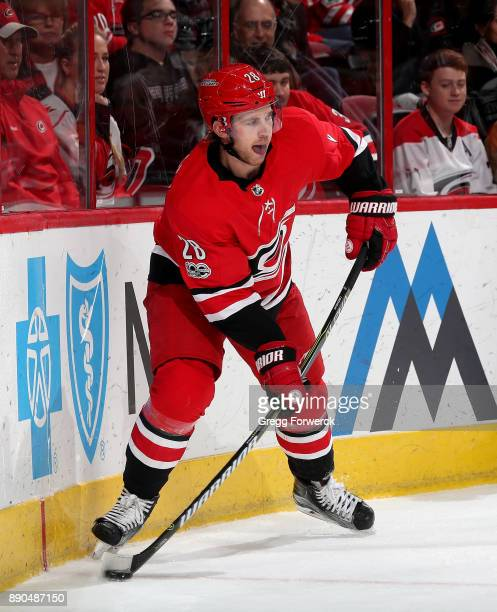 Elias Lindholm of the Carolina Hurricanes controls the puck along the boards during an NHL game against the Florida Panthers on December 3 2017 at...