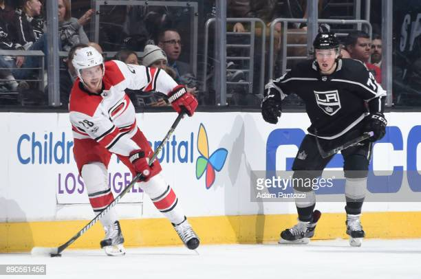 Elias Lindholm of the Carolina Hurricanes looks to pass the puck during a game against the Los Angeles Kings at STAPLES Center on December 9 2017 in...