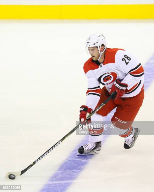 Elias Lindholm of the Carolina Hurricanes plays the puck down the ice during second period action against the Winnipeg Jets at the Bell MTS Place on...