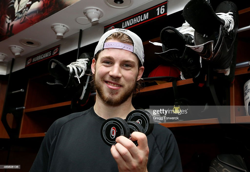 <a gi-track='captionPersonalityLinkClicked' href=/galleries/search?phrase=Elias+Lindholm&family=editorial&specificpeople=8613151 ng-click='$event.stopPropagation()'>Elias Lindholm</a> #16 of the Carolina Hurricanes poses after scoring his first NHL hat trick during a game against the Edmonton Oilers at PNC Arena on March 8, 2015 in Raleigh, North Carolina.